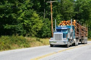 Logging Truck and Strawberry Truck Collide in Marshall County